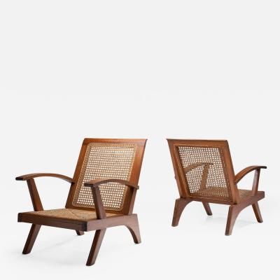 A Pair of French Teak Armchairs France 1950s