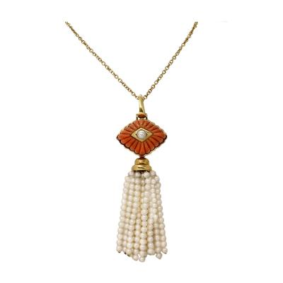 A Clunn carved coral and pearl pendant