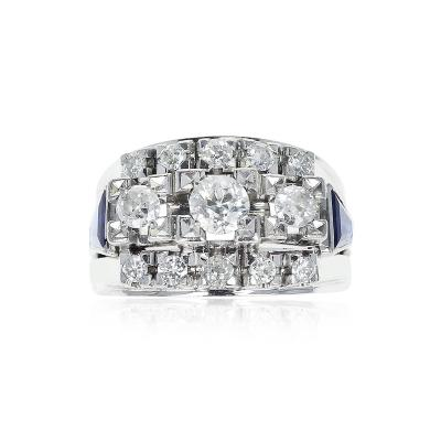 1950S THIRTEEN ROUND DIAMOND ACCENTED WITH TWO SAPPHIRE TRAPEZOIDS 18K GOLD
