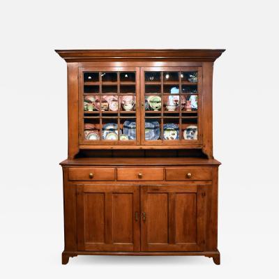 19th C PA walnut two part set back cupboard