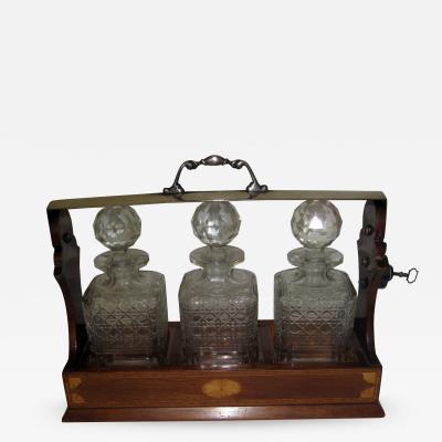 19th Century Georgian Inlaid Mahogany Tantalus with Three Decanters