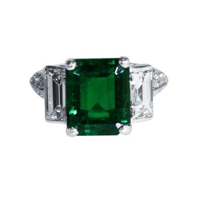 4 64 Carat Emerald and Diamond Ring