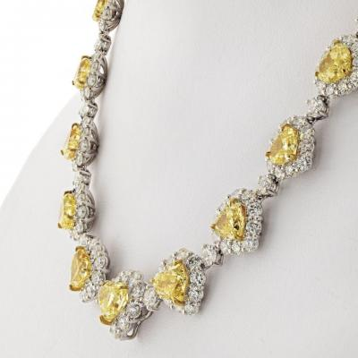 50 CARAT FANCY INTENSE YELLOW HEART AND WHITE DIAMOND INFINITY NECKLACE