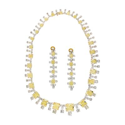 94 65 CTS RADIANT CUT FANCY YELLOW DIAMOND INFINITY NECKLACE