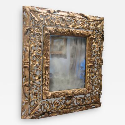 A 17th Century Spanish Colonial Carved and Gilded Mirror