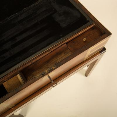 A 19th C English lap desk on wooden stand circa 1860