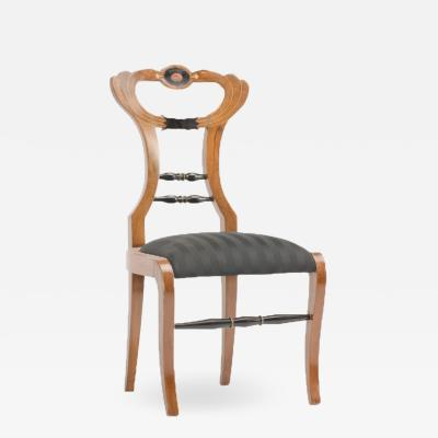 A 19th Century Biedermeier chair upholstered with black striped silk fabric