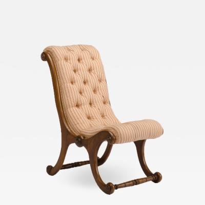 A 19th Century walnut chair tufted upholstered