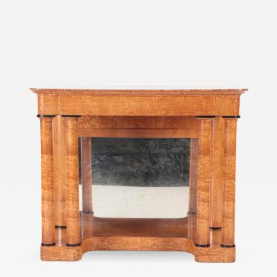 A 19th century figured elm console resting on four round Doric style columns