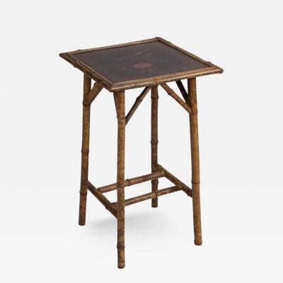 A Bamboo Table with Double Stretcher and Black and Red Painted Face