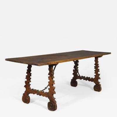 A Baroque Period Trestle Ended And Forged Iron Table