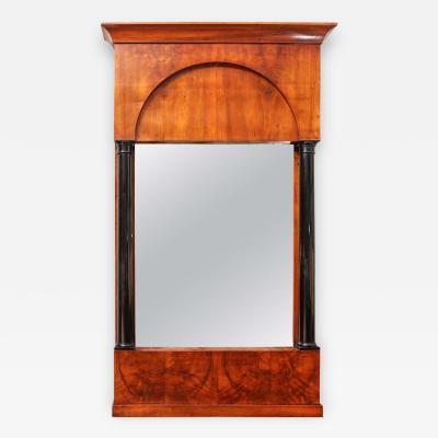 A Biedermeier Style Mirror in Walnut Flanked with Ebonized Columns