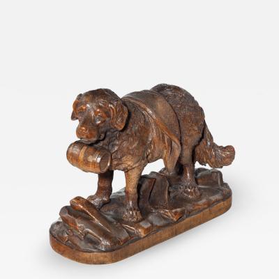 A Black Forest carved linden wood model of a mount rescue dog