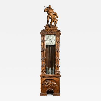 A Black Forest linden wood long case clock by Spring of Interlaken