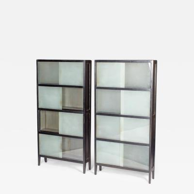 A Bookcase with Sliding Alternating Clear and Frosted Glass Panels