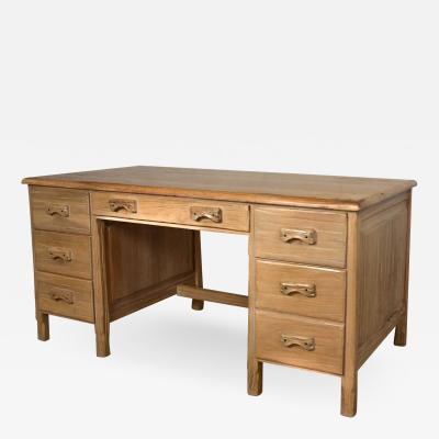 A Brandt Ranch Oak Furniture Vintage ranch oak desk with honey oak finish by a brandt company