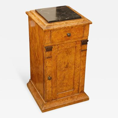 A Burl Wood Pedestal Stand with Black Marble Top and Single Door and Drawer