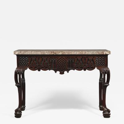 A Carved George II Cuban Mahogany Side Table Of Predominantly Gothic Taste