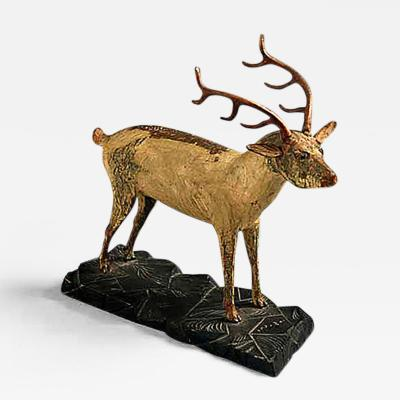 A Carved and Painted Pine Deer