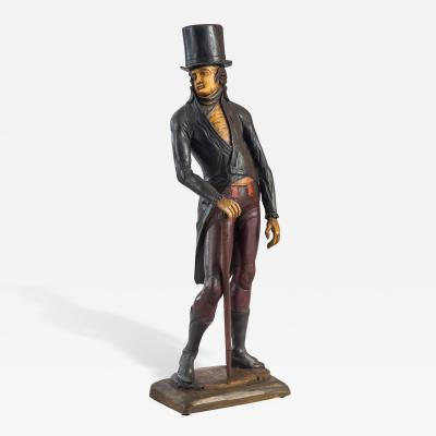 A Carved and Painted Wood Figure of a Man with Cane and Top Hat
