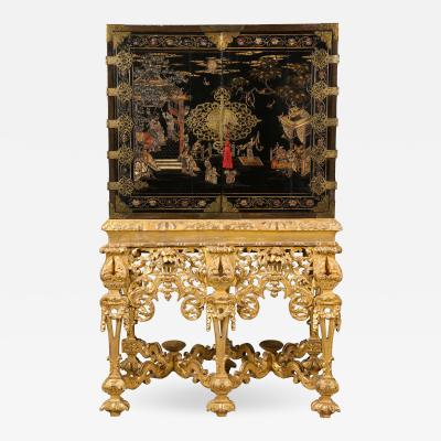 A Chinese Brass Mounted Lacquer Cabinet on a Charles II Gilt wood Stand