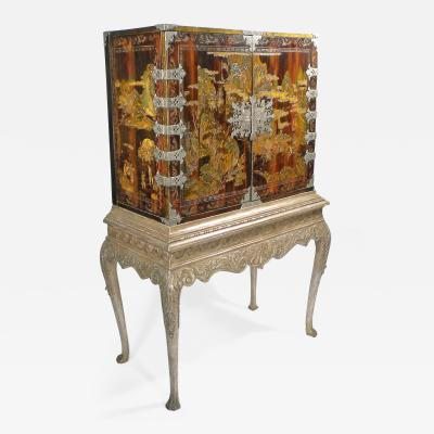 A Chinese Coromandel Cabinet on Stand