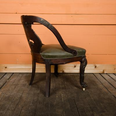 A Chinese carved dragon chair with leather seat 19th C