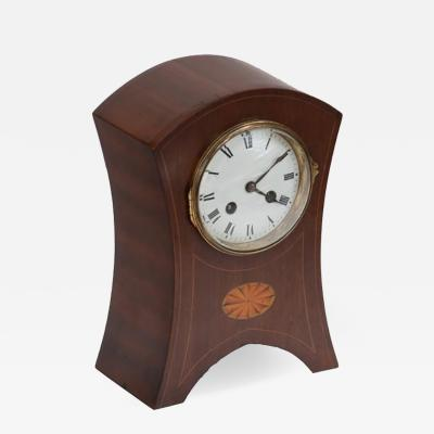 A Clock in Mahogany with Inlay