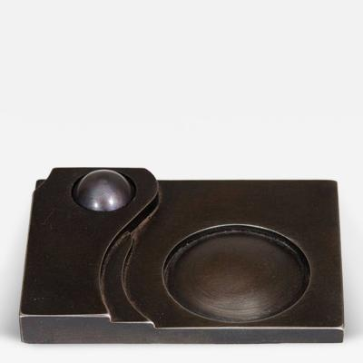 A Contemporary Art Deco Style Steel Paperweight