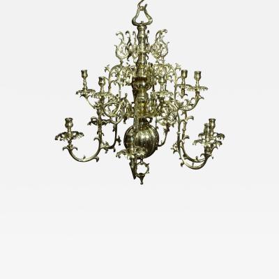 A Continental Twelve Light Brass Chandelier