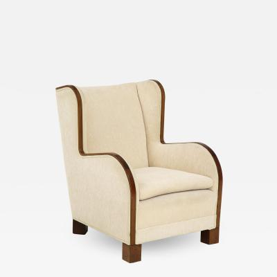 A Danish Design Mahogany Wing Chair Circa 1930s