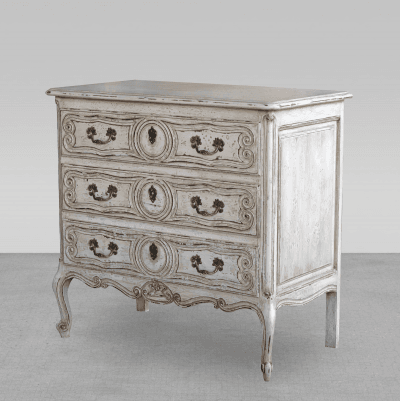 A Diminutive French Rococo Style Ivory Painted 3 Drawer Commode