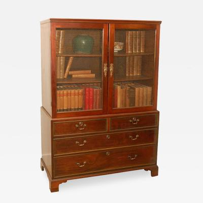 A Display Bookcase in Mahogany with Bbrass Inlay and Brass Screen Door Inserts