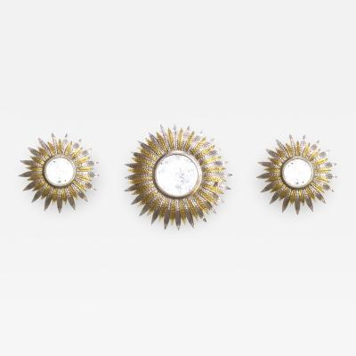 A Fanciful Set of 3 French Art Deco Silver and Gold Gilt Sunburst Mirrors