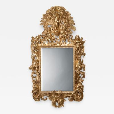 A Fine And Decorative Italian Gilt Wood Mirror