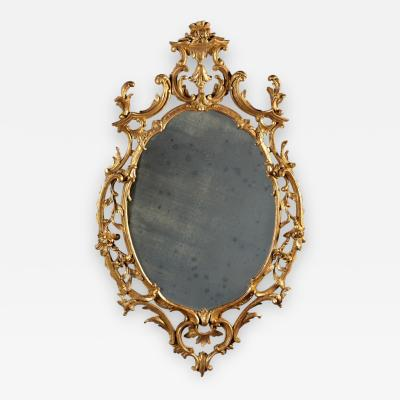 A Fine Chippendale Period Carved Giltwood Oval Mirror
