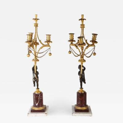 A Fine Pair of 18th Century Bronze and Gilt Bronze Candelabra