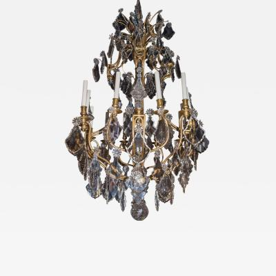 A Fine Quality French Gilt Bronze and Crystal Twelve Light Chandelier