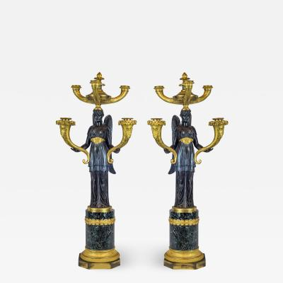 A Fine Quality Pair of Empire Patinated and Gilt Bronze Five Light Candelabras