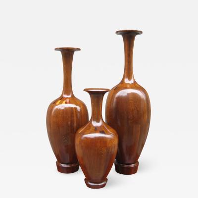A Fine Set of Three Decorative Wood Vases