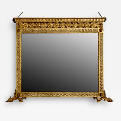 A Finely Carved and Gilded Mirror with Dolphin Feet