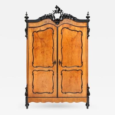 A Flemish Walnut and Ebonised Armoire