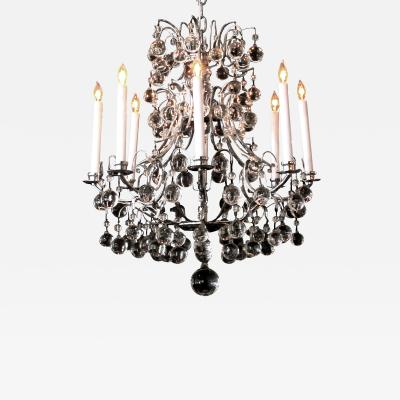 A French 1960s chrome basket form 8 light chandelier with crystal spheres