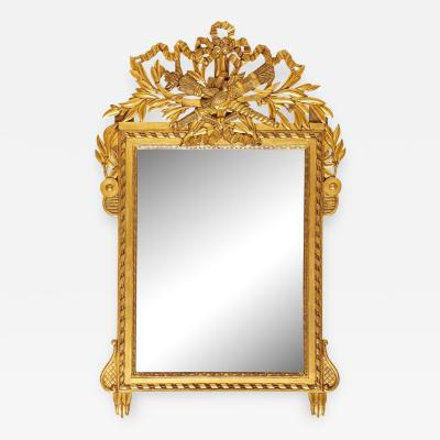 A French Empire Style Giltwood Mirror