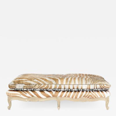 A French Louis XV style painted bench or daybed with richly carved apron