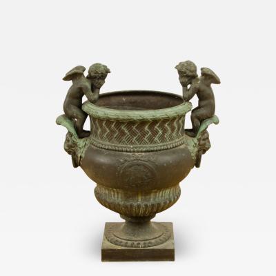 A French cast bronze garden urn with cherubs circa 1910