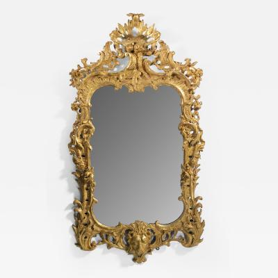 A GEORGE II STYLE GILTWOOD MIRROR