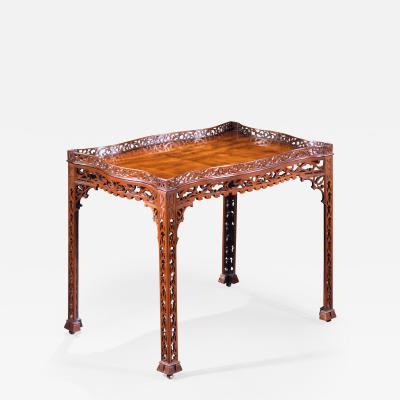 A GEORGE III STYLE MAHOGANY SILVER TABLE