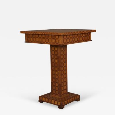 A Geometric Oak and Mahogany Parquet Square Pedestal Center Table