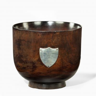 A George III punch bowl made of oak from H M S Royal George 1802